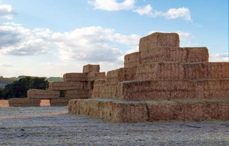 a stack of straw stacked on top of each other in the form of a castle at sunset