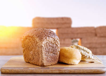 decoration of white flour on brown toast bread and sunset background