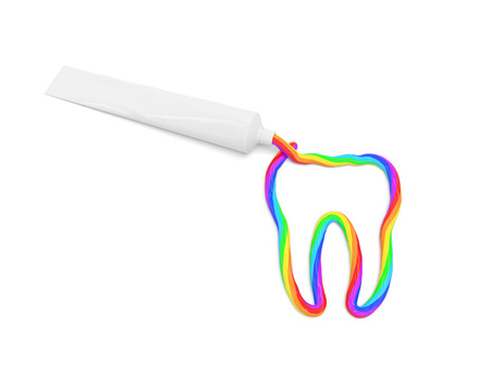 The color toothpaste in the form of tooth is squeezed out from a tube photo