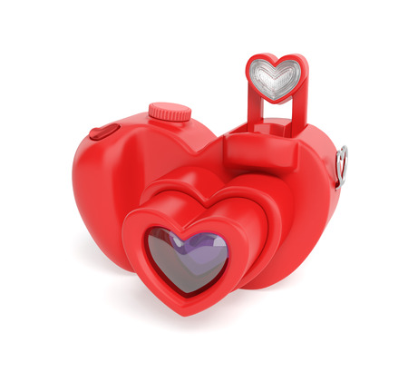 distinctive: Camera Valentine day creative concept: unusual digital photo camera in the form of red heart with distinctive design as symbol of capture the photos (photography) of happy life of lovers