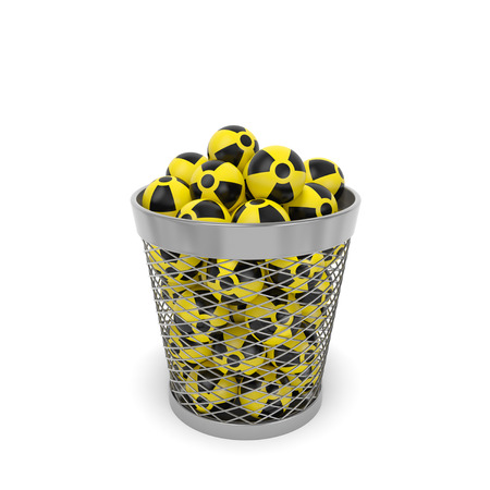isotopes: Nuclear waste radiation ecology concept. Radioactive isotopes with nuclear sign in the trash bin wastebasket as symbol of serious problem of atomic waste utilization and environmental conservation Stock Photo