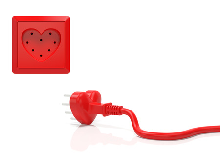 Heart love passion creative concept. Electric plug and power socket in the form of red heart as symbol of Valentine day, infatuation, wedding, romantic date, love in every home or time for love 免版税图像