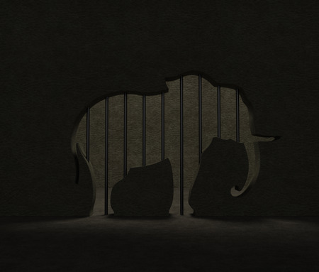 gaol: Elephant protection. Zoo cage (enclosure) with grate bars as elephant silhouette as symbol of harmful living conditions of elephants or International Day of Action for Elephants in Zoos