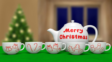 Merry Christmas (festive card). White ceramic teapot with text and cups with xmas symbols on green table on blurred background as winter holiday, invitation for cozy family celebration.