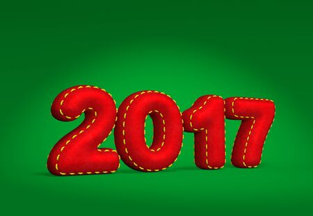 2017 New Year numbers as red silk velvet fabric throw pillow or handmade cushion with golden thread on green background with light effect as symbol of New Year homelike festive atmosphere 免版税图像