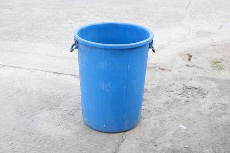 blue bin: Blue garbage trash bin on road
