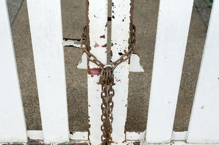 keep gate closed: the door with chain padlock Stock Photo