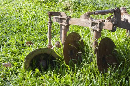 plough machine: Close-up Tractor plow on Lawn, Thailand Stock Photo