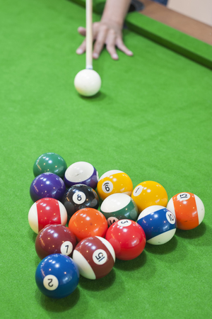 cue sticks: Snooker player Stock Photo