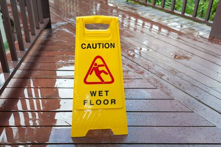 alerts: Yellow sign that alerts for wet floor