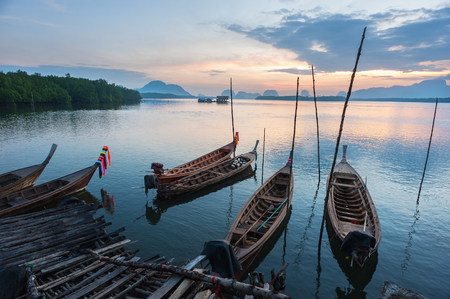 long tailed boat: andaman long tailed boat southern of thailand floating on  sea water with sun shine Stock Photo