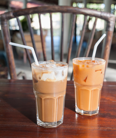 Thai Ice Tea milk and Ice Coffee on wood table Stock Photo