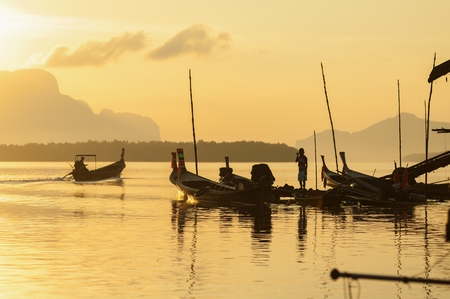long tailed boat: Landscape of andaman long tailed boat southern of thailand floating on sea water with sun shine