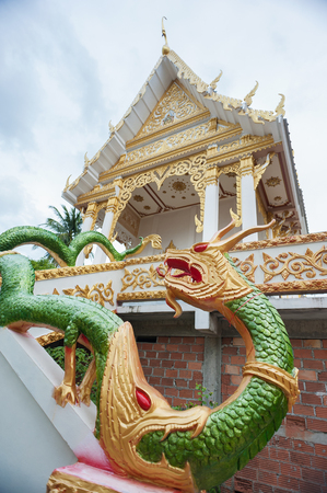 mythical: Serpent is a mythical animal which was created in front of the main chapel at Buddhist temple as a holy guardian