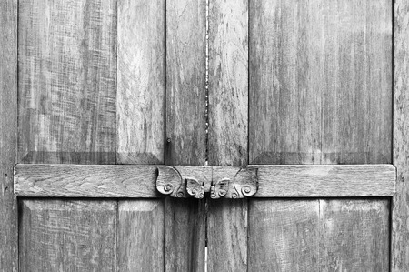 water stained: Obsolete wooden door bolt, Thai tradition;monochrome