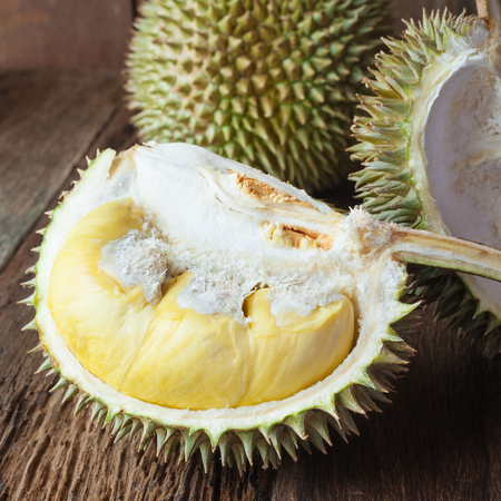 dissect: yellow Durian on wood table
