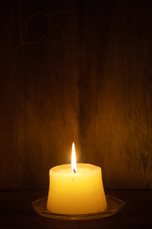 outage power: candles on old wooden background