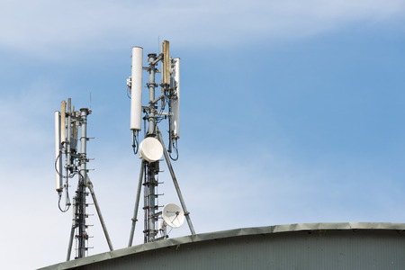 repeater: Close up white color antenna repeater tower on blue sky Stock Photo
