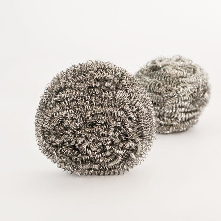 stainless steel scourer on white background