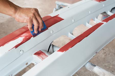 repaint: Car paint repair series : Working on putty Stock Photo