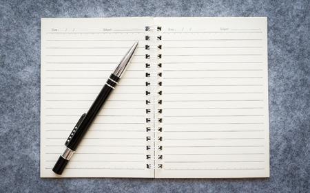 memorandum: Lined notebook and pen, checklist memo reminder memorandum
