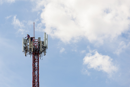 maintenance work repeater telecommunication tower with blue sky Stock Photo