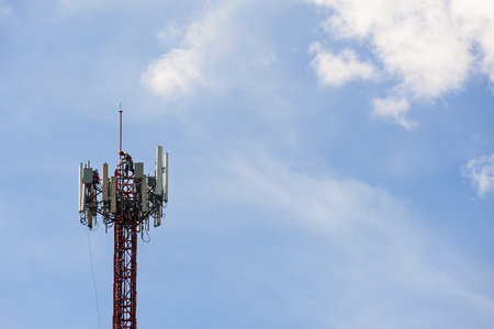 telephone poles: maintenance work repeater telecommunication tower with blue sky Stock Photo