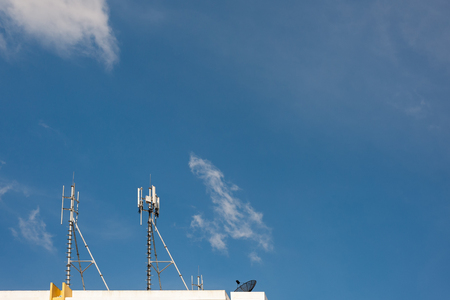 white color antenna repeater tower on blue sky Stock Photo