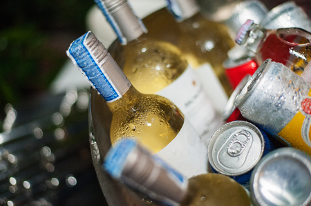 Wine bottle in an ice bucket. With other beverages. Stock Photo