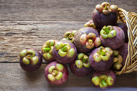 Mangosteen fruit on wood table with top view