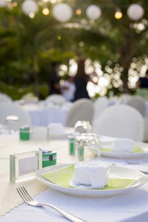 Romantic dinner setting  in garden Stock Photo