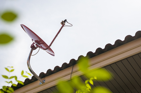 Satellite dish on roof with  copy space