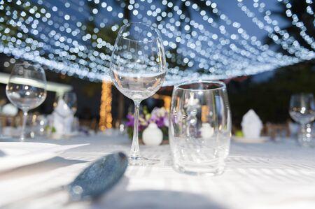 Romantic dinner setting  in garden with boken light Banco de Imagens