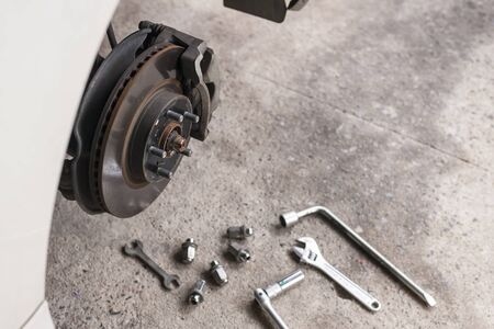 mechanic changing a wheel car Stock Photo