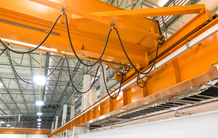 factory overhead crane on a yellow beam Close up