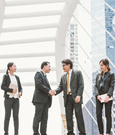 Business people shaking hands, finishing up a meeting. Negotiation benefits concept Stock Photo