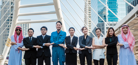 Hand coordination togetherness Multicultural business people group including Arabic, East Asian, Latin American standing in modern city. Concept of multi ethnic, multiracial business team. 版權商用圖片