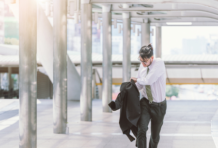 Stressed anxious businessman in a hurry and running, he is late for his business appointment and Wear a shirt while running. Reklamní fotografie - 83404589