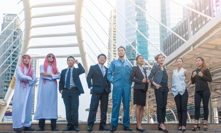 career of Multicultural business people group including Arabic, East Asian, Latin American standing in modern city. Concept of multi ethnic, multiracial business team. 版權商用圖片