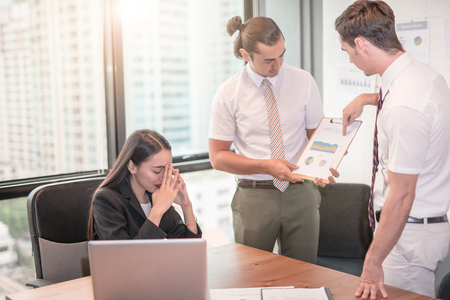 Young manager presenting whiteboard to his colleagues about financial growth and Disappointed boss Stock Photo