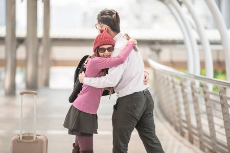 Welcoming embrace. Young loving couple hugging in the airport terminal.