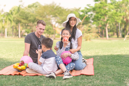 Young family with children having fun in nature Stock Photo