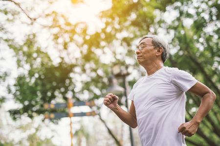 Asian senior mature man running Jogging In Park