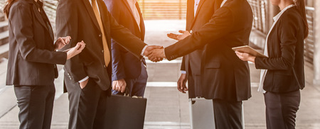business people  handshake concept. shaking hand of group of businessman negotiation closing a deal city background
