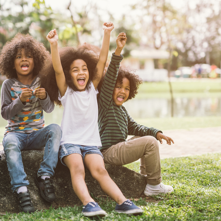Happy African american little boy kid children joyfully cheerful and laughing. Concept of happiness, gladness and fun. Reklamní fotografie