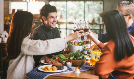 Dinner with friends. Group of young people enjoying dinner together. Dining Wine Cheers Party Concept
