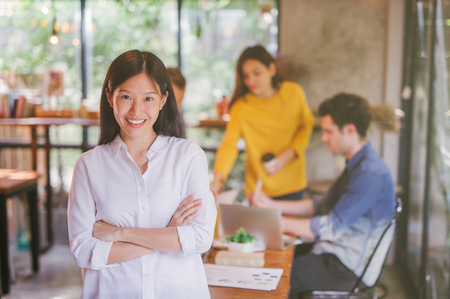 Portrait of asian female leader of working team coworking office ,Smiling of happy chinese girl in modern office