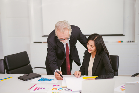 senior businessman sign a contract in office