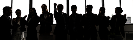 Silhouette of Business People Celebrating In Board Room Imagens