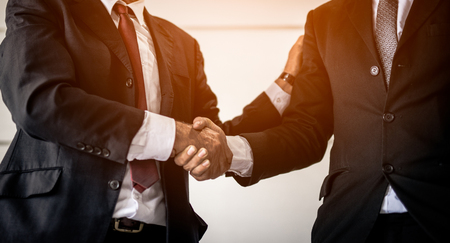Business people partnership handshake concept.Photo two businessman handshaking process.Successful deal after great meeting.